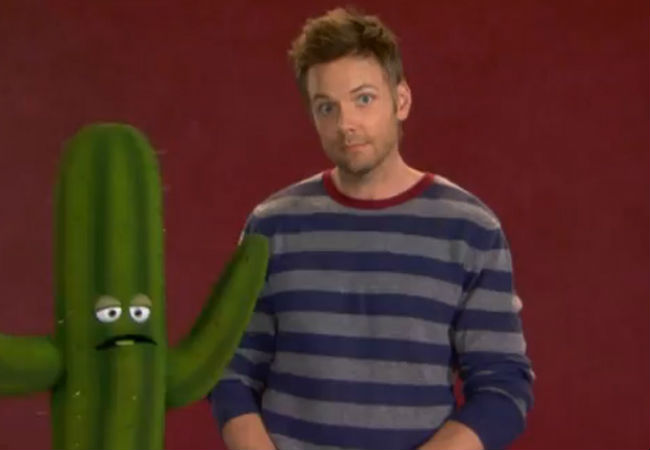 Joel McHale from Community and his prickly new friend the cactus (image via babble.com)