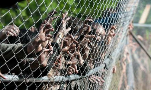 Rick's plans for a mosh pit at the prison music festival backfired when the walkers got a little too much into it (image via comicsalliance.com (c) AMC)