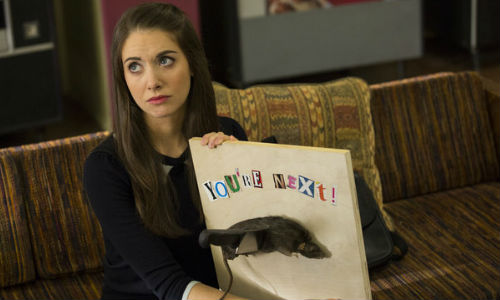 Annie with the rat, a message that will no doubt lead to some sort of insanely loopy conspiracy (image via hitfix.com (c) NBC)