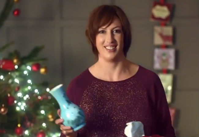 "Miranda Hart doing an exemplary job of ""loving"" the vase she has been given as a gift (image via YouTube.com (c) BBC)"
