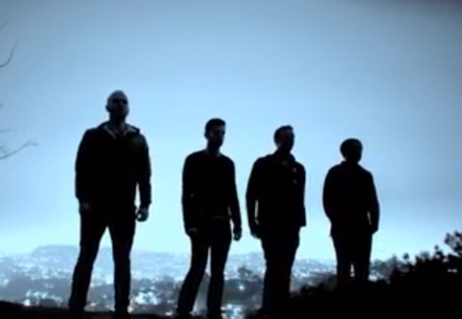 Coldplay in the pre dawn light (image via Youtube.com)