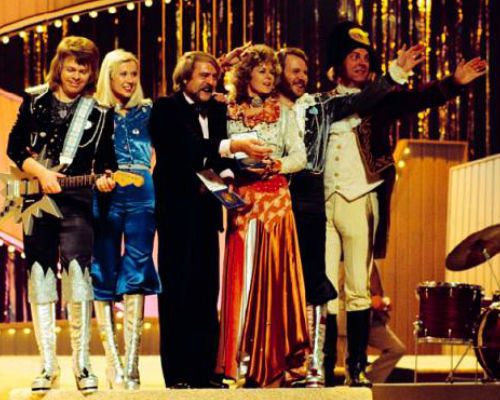 "ABBA on stage following their historic win with manager Stikkan ""Stig"" Anderson and orchestra conductor Sven-Olof Walldof (image via"