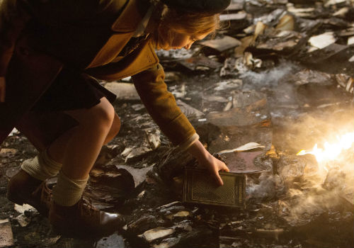 Liesel love of books and reading is very much on display but the movie fails to adequately convey how important they become to her (image via soundandmotionmag.com)
