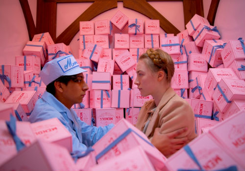 Zero and Agatha find themselves awash in boxes of Mendl's pastries in one of the film's many visually and narratively inventive scenes (image via nerdist.com)