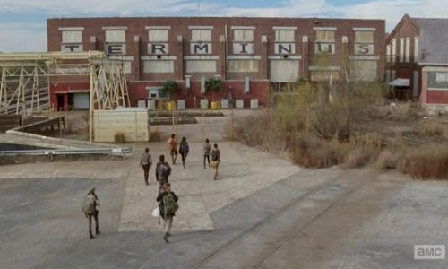 Ah home sweet mother of hell on earth (possibly) home ... the lead group arrives at Terminus, eerily quiet, guarded in the most lax manner possible and they may, just may, be on the menu (image (c) Glen Page/AMC via tv.com)