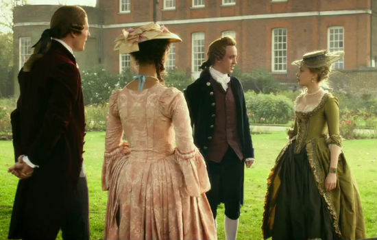 Belle confronts some of the suffocating mores of English society when she and Elizabeth journey to London to come out and be married off (It is only Elizabeth who is officially allowed to do so with Dido having to do it under the radar so too speak), in this case doing their best to impress the sons of Lord Ashord, played by Tom Felton and James Norton (image via Felt Beats (c) Fox Searchlight)