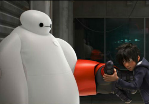 Hiro Hamada and his robot Baymax (image via Moviefone (c) Disney/Marvel)