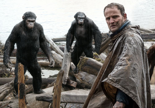 Jason Clarke leads a small group of humans who have survived the virus and taken to the woods to survive the apocalyptic breakdown of what is left of human society (image via Screen Crush)