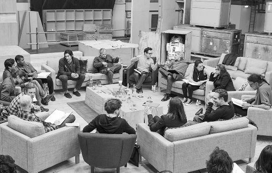 April 29th, Pinewood Studios, UK - Writer/Director/Producer J.J Abrams (top center right) at the cast read-through of Star Wars Episode VII at Pinewood Studios with (clockwise from right) Harrison Ford, Daisy Ridley, Carrie Fisher, Peter Mayhew, Producer Bryan Burk, Lucasfilm President and Producer Kathleen Kennedy, Domhnall Gleeson, Anthony Daniels, Mark Hamill, Andy Serkis, Oscar Isaac, John Boyega, Adam Driver and Writer Lawrence Kasdan. Copyright and Photo Credit: David James. (via Star Wars official site)