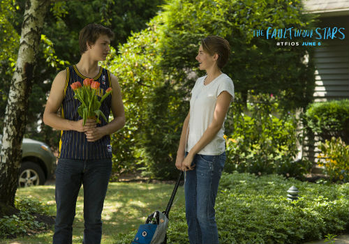 Gus and Hazel share a warmth and intimacy borne of shared trauma and an unwillingness to let the well-meaning sentiments of inspirational posters define them (image via official The Fault in our Stars movie site)