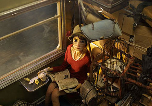 Surrounded by an avalanche of luggage, Madame Tutli-Putli finds herself drawing a series of disconnected but mysterious events onboard the train on which she's travelling with an intriguingly odd assortment of characters (image via Cartoon Brew)