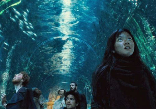 Unused to the many luxuries of the front end of the train, the rebels wander through the aquarium carriage awe-struck and speechless, a brief respite from the pell-mell violence of their quest for equality and humanity (image via Movie Mezzanine)
