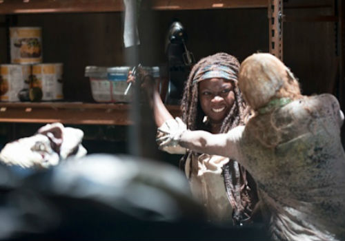 Now this is living! Even in a murky pool full of rotting zombies, Michonne is loving where she is now a million times more than where she once was (image (c) Gene Page/AMC)