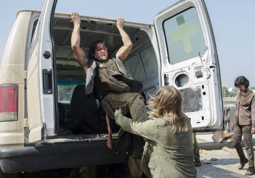 Fresh out of crossbows, Daryl resorts to kicking, pushing and employing the mother of all escape routes, tips ambulance off a bridge with he and Carol, all on the premise that while they live and breathe, there is hope (Photo by Gene Page/AMC)