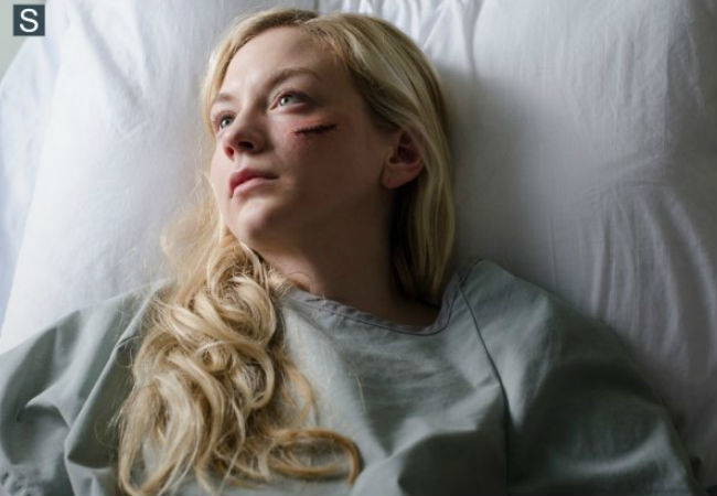 Where o' where o where have you been Beth (Emily Kinney)? Not even Beth is sure about that when she first awakes in a sterile clean hospital room with views of a city and the company of persons and motivations unknown (image (c) Photo by Gene Page/AMC via Spoiler TV)