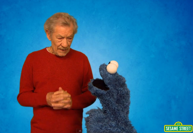 Sir Ian McKellen and Cookie Monster learning how to resist (image via YouTube (c) Sesame Street / Children's Television Workshop)