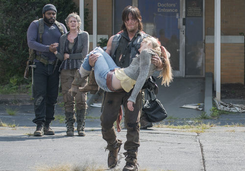 Bereft beyond words Daryl tenderly carries Beth's body out to her grieving sister who has just arrived full of hope for a reunion with the only living family member she has left (image via AMC/Gene Page)