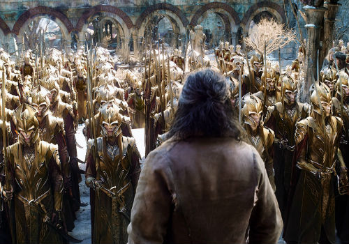Thorin (Richard Armitage) surveys some of the massed Elvish forces of the coldly calculating Elf King Thranduil (Lee Pace) who rides in to save the day ... for himself (Image via Film Blerg (c) New Line Cinema)