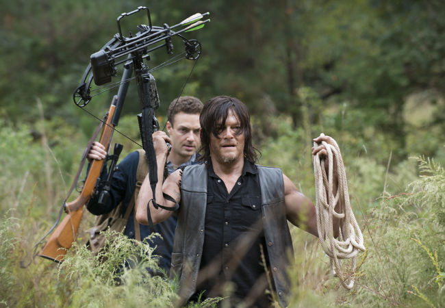 "thanks to a series of small but genuine and well thought-out gestures by Aaron, Daryl goes from ""Person most likely to shoot his way OUT of the Alexandria Safe Zone"" to possibly its greatest cheerleader, next to Deanna (Photo by Gene Page/AMC)"