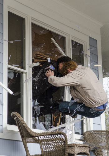 And out the window they go, Rick and Peter taking their manly physical banter a little too far (Photo by Gene Page/AMC)
