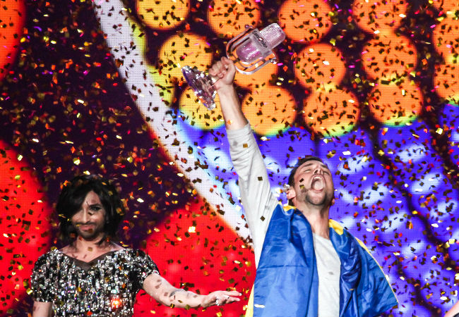 Måns Zelmerlöw stans triumphant after he wins this year's Eurovision Song Contest after an early neck-and-neck tussle in the voting with Russia (image Elena Volotova (EBU) via Eurovision.tv)