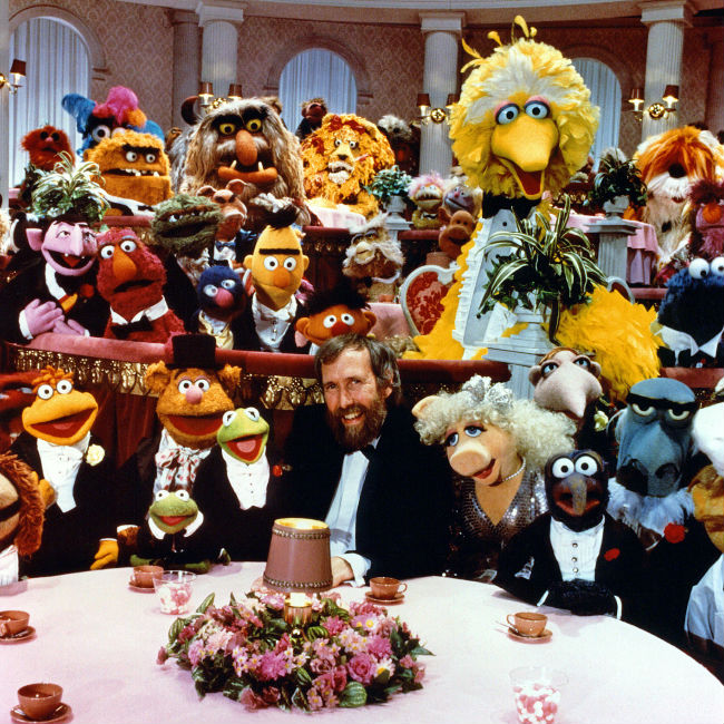The late much-missed Jim Henson and his Muppet family (image via Muppet Wikia (c) Disney / Sesame Workshop)