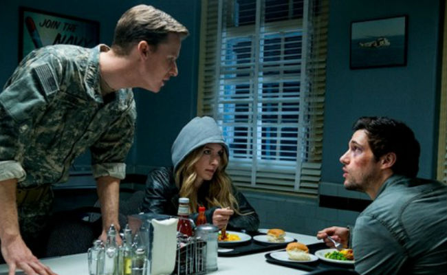 """Hal and Maggie sit down for a lovely candlelit, OK well dinner of some kind in the mess of the 14th Virginia - hottest eating spot in town! Yeah, no it's not - when one of the """"We're bad, we're bad, we know it"""" soldiers comes up to harass them, cliche-style (image via TV Equals (c) TNT)"""