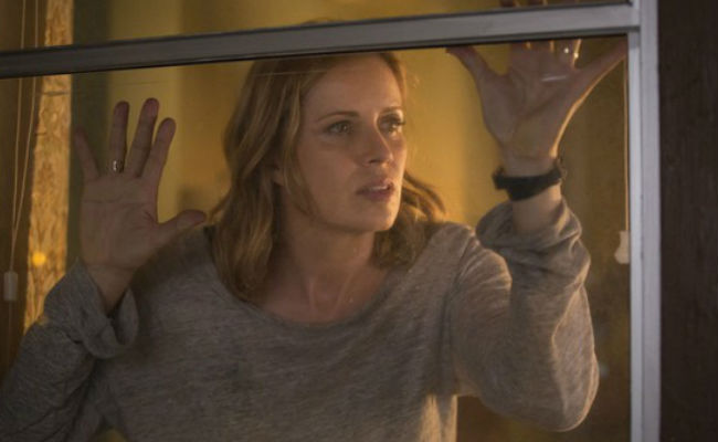Madison realises with horror that the windows in her prison ... er, house are dirty (image via TV.com (c) AMC)