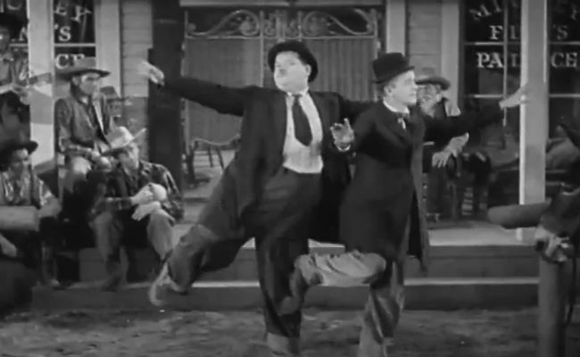 Laurel and Hardy dance to Morrissey in a scene from Way Out West (image via Vimeo)