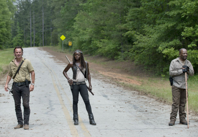 Rick, Michonne and Morgan pause during their daily constitutional to ponder their good fortune ... OR, and this is more likely, get ready to fight a HUGE number of walkers (image via The Young Folks (c) AMC)