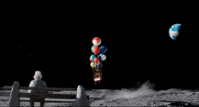 The Man on the Moon receives an unexpected girl from Lily, a kindhearted young girl on Earth (image via YouTube (c) John Lewis department store)