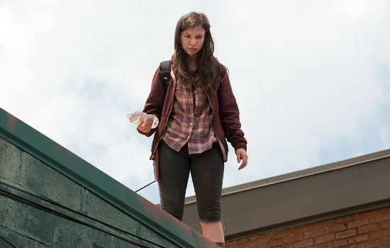 Voted Most Accurate Representative of a Pissed-off Teenager in the Apocalypse 1 year in a row by the residents of Alexandria, Enid is tromping her way through the apocalypse, unhappy about EVERYTHING DAMMIT! (Image courtesy AMC)