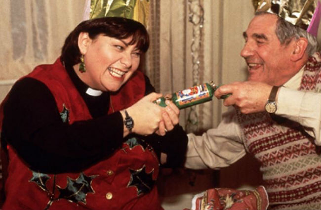Ah bon bons! So festive and yet so hilariously violent ... Geraldine (Dawn French) and Jim Trott (Trevor Peacock) have some fun opening one at the first of the vicar's many lunches (image courtesy BBC and Tiger Aspect Productions)
