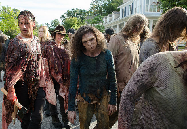 "In a sign that the living and the dead aren't that far apart after all, both Rick Grimes and Fashionablt-Attired Zombie Lady both adopt the ""Did I leave the iron on?"" look at exactly the same time (image courtesy AMC)"