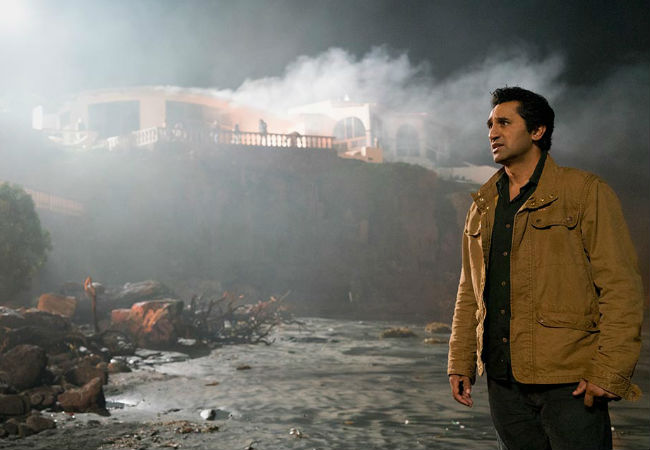 Curtis stands on the beach below Strand's mansion, LA burning above and beyond him ... and no, neither John Lee Hooker nor Ladyhawke really wrote a song about this (image courtesy AMC)