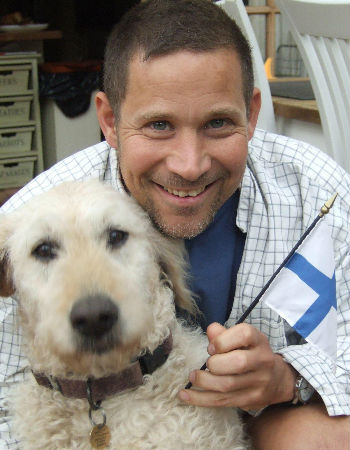 Cristof and one of his beloved Labradoodles (image courtesy Cristof Fischer)