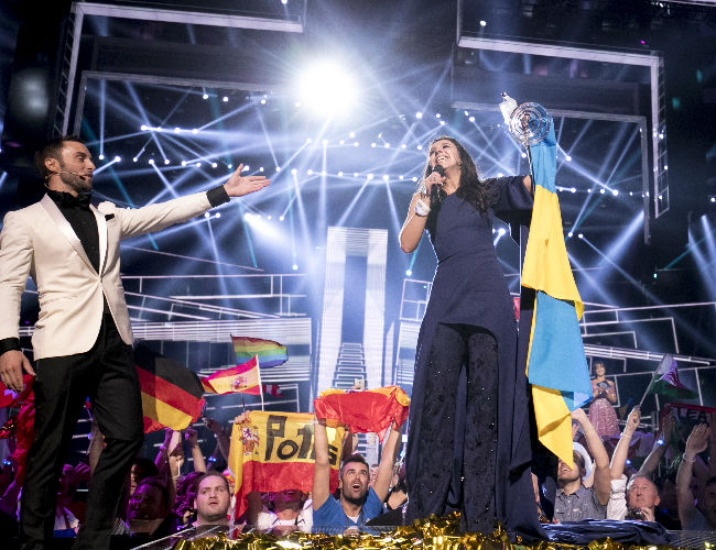 Winner of the Eurovision Song Contest 2015 and this year's co-host Måns Zelmerlöw presents an understandably thrilled Jamala from Ukraine as the winner of this year's event (photo (c) Andres Putting EBU)