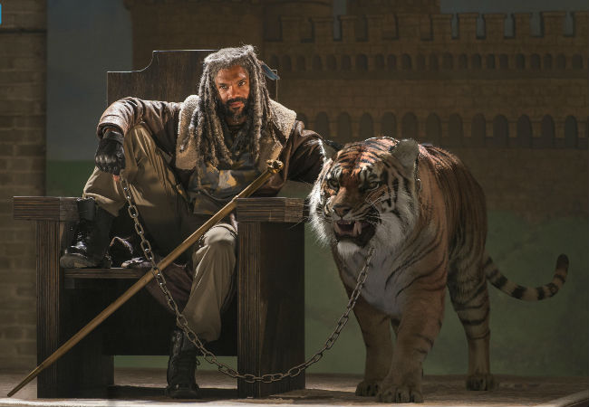 It's the zombie apocalypse so pronouncing yourself king and getting a big ass tiger to sit by your throne is totally and utterly normal okay? (image courtesy AMC)