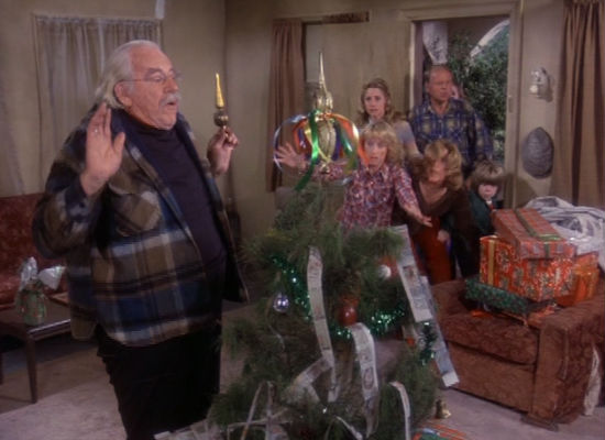 Following a sighting of the family's stolen car, everyone bursts in on Sam to retrieve their gifts and save Christmas but the thief ends up playing a key role in the family's celebration of the day (image via Christmas TV History (c) Warner Bros)